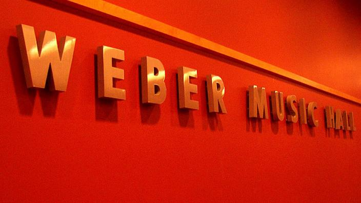 """UMD the words """"Weber Music Hall""""with red background"""