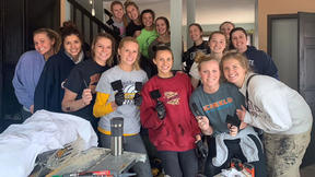 UMD volleyball team painting a home for Habitat for Humanity