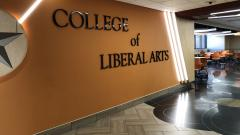 College of Liberal Arts sign on the wall of Cina Hall