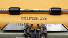 "Typewriter and paper with the words ""Chapter One"""