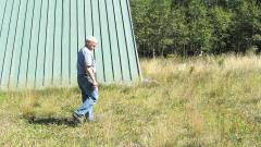 David Yount of the Unitarian Universalist Congregation of Duluth walks on the green roof, installed in 2007, of their church at 835 West College Street in Duluth, Minnesota.