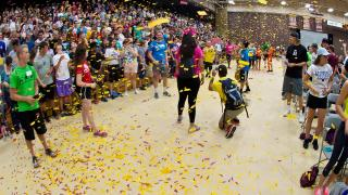 New freshman celebrating with confetti at the new student convocation