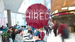 "LSBE scene with the text ""Bulldogs Hired"""