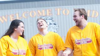 Welcome week coordinators share a laugh.