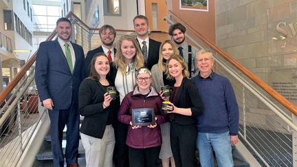 UMD Mock Trial Competition team holding awards they received