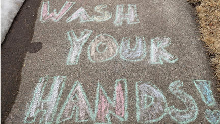 "Photo of chalk drawing that says ""Wash Your Hands"""
