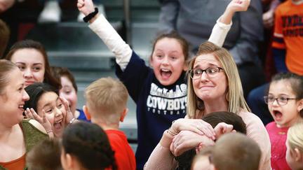 UMD alumna Brittany Larson's students cheer at the news of the award.