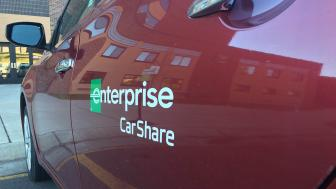 Enterprise car share sign next to the red car share vehicle