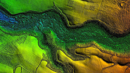 Brightly colored aerial shot of forest and river