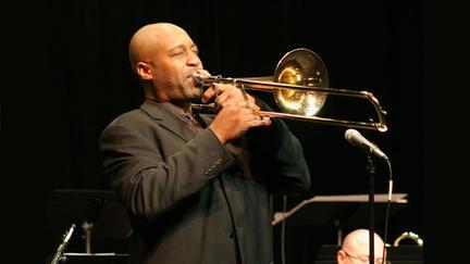 Musican Andre Hayward playing trombone
