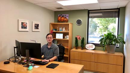 UMD math alumnus Feng Qian in his office