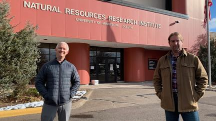 NRRI researchers Tim White and Kevin Kangas standing in front of the NRRI building