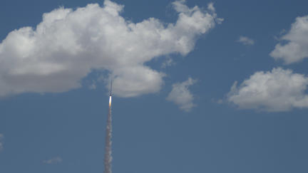 Rocket ascending into the clouds