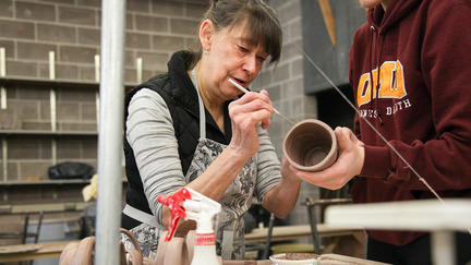 UMD School of Fine Arts Assistant Professor Elizabeth James working on a clay pot
