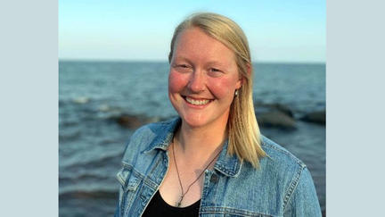 UMD SCSE graduate student Kirsten Rhude with Lake Superior in the background