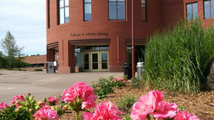 UMD's Kathryn A. Martin Library with pink flowers in foreground