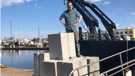 UMD LLO researcher Jay Austin with 1000 pound concrete weights