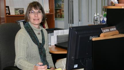 NRRI Associate Director Lucinda Johnson sitting at her desk