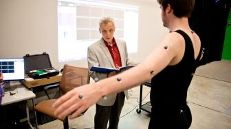 A professor looking at a dancers movement through MMAD Lab motion capture