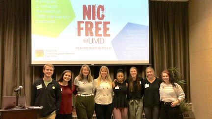 "UMD CESHP students standing in front of screen that says ""Nic Free at UMD"""