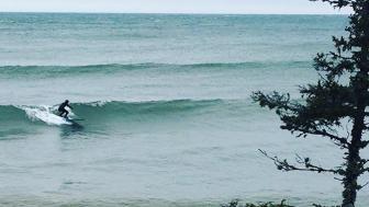 Nick Wagner surfs Lake Superior