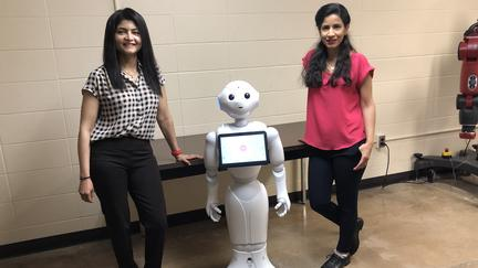 Arshia Khan and Mahsa Soufineyestani with Pepper the Robot