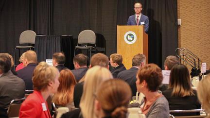 People listening to a speaker at an REIF breakfast in Duluth, Minn.