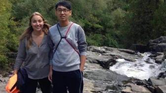 An American student give a Chinese student a tour of Duluth's Chester Park.