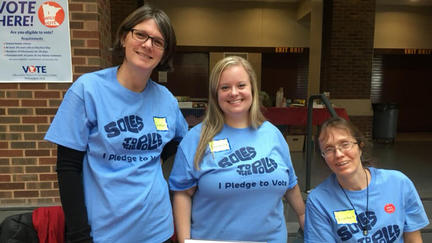 UMD faculty member Sandra van den Bosse with two other people in matching blue t-shirts