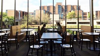 Students enjoying a meal by the spacious windows of UMD's new Superior Dining