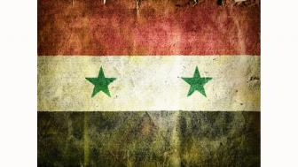 a battered-looking Syrian flag