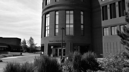 Black & white image of the outside of UMD's Kathryn A. Martin Library