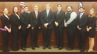 UMD's Mock Trial team in a judicial chamber
