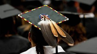 Back of mortar board with a feather and bead work.