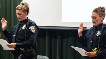 UMD Police Department's new officers, Officer Dawn Valure and Officer Kalika Pukema, being sworn in