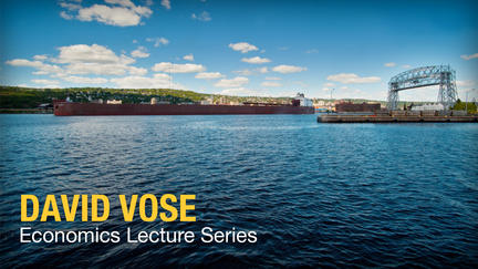 "Photo of the Duluth Aerial Lift Bridge with the words ""Vose Economics Lecture Series"""