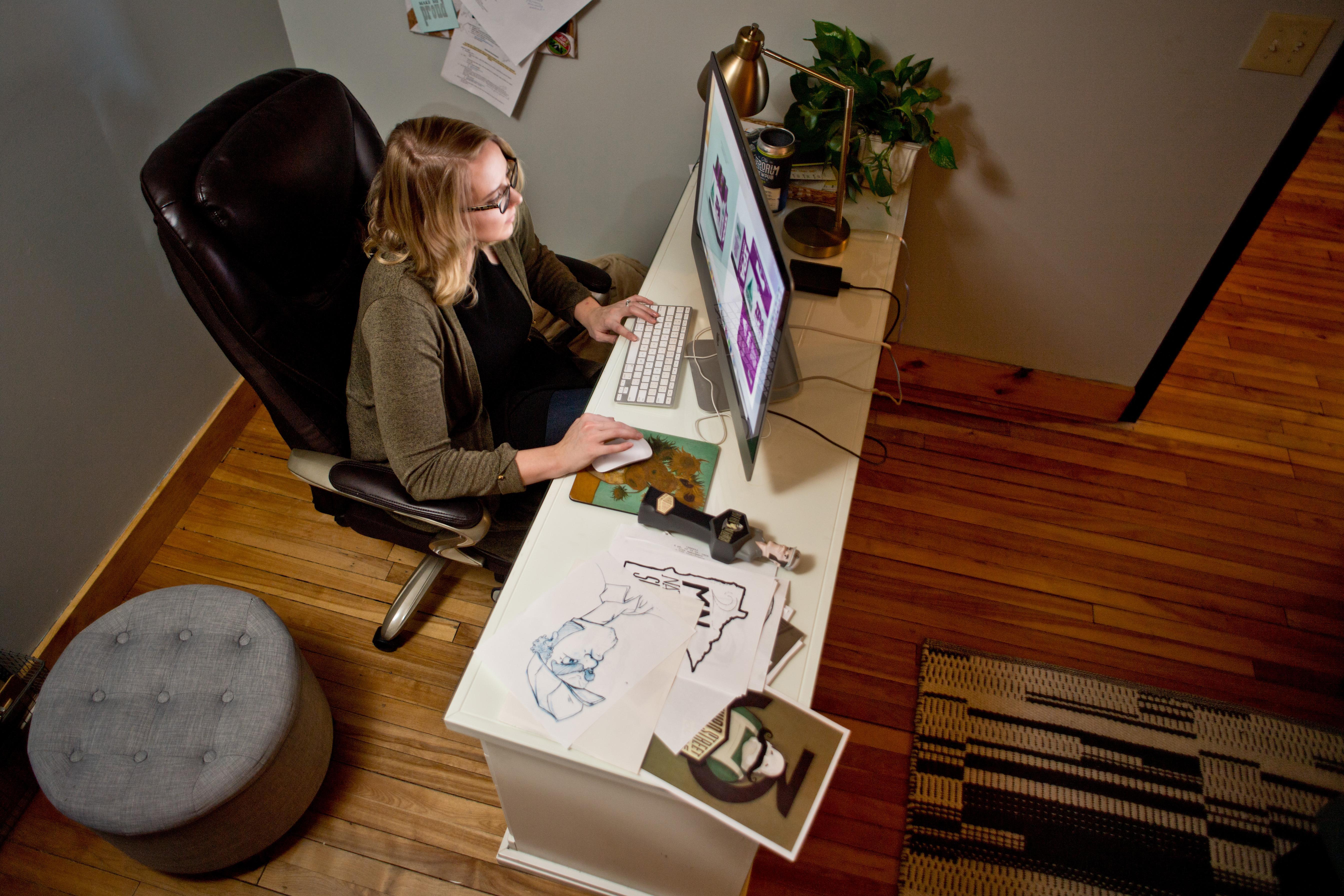 Jodie Pundsack of Gaslight Creative working at her desk