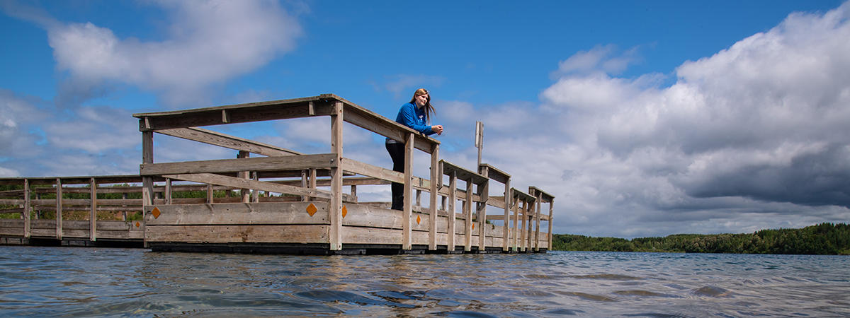 Jacee standing on a dock at home