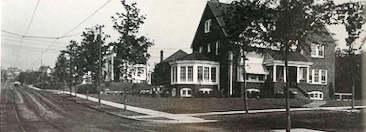 home at 24th Ave East and First Street was built in 1911, just five blocks from Old Main. The trolley car tracks and overhead lines are clearly visible in the photo.