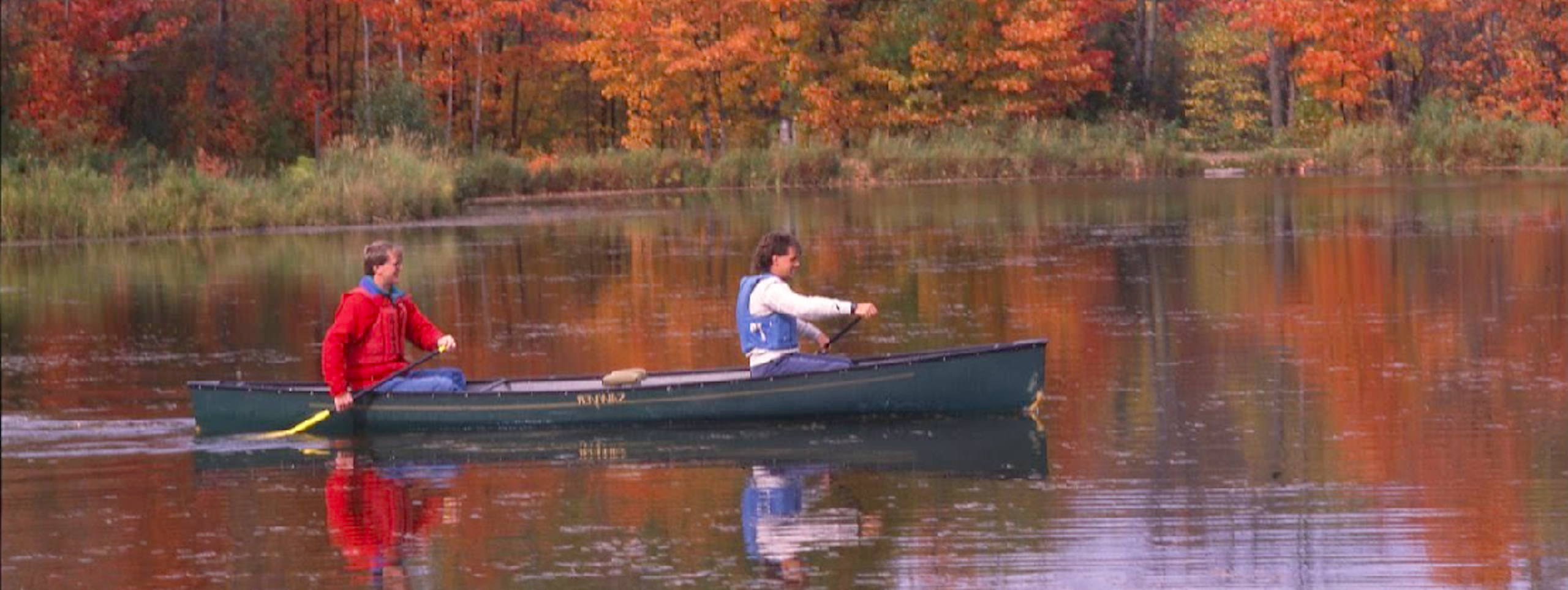 UMD students in a canoe on Bagley Pond