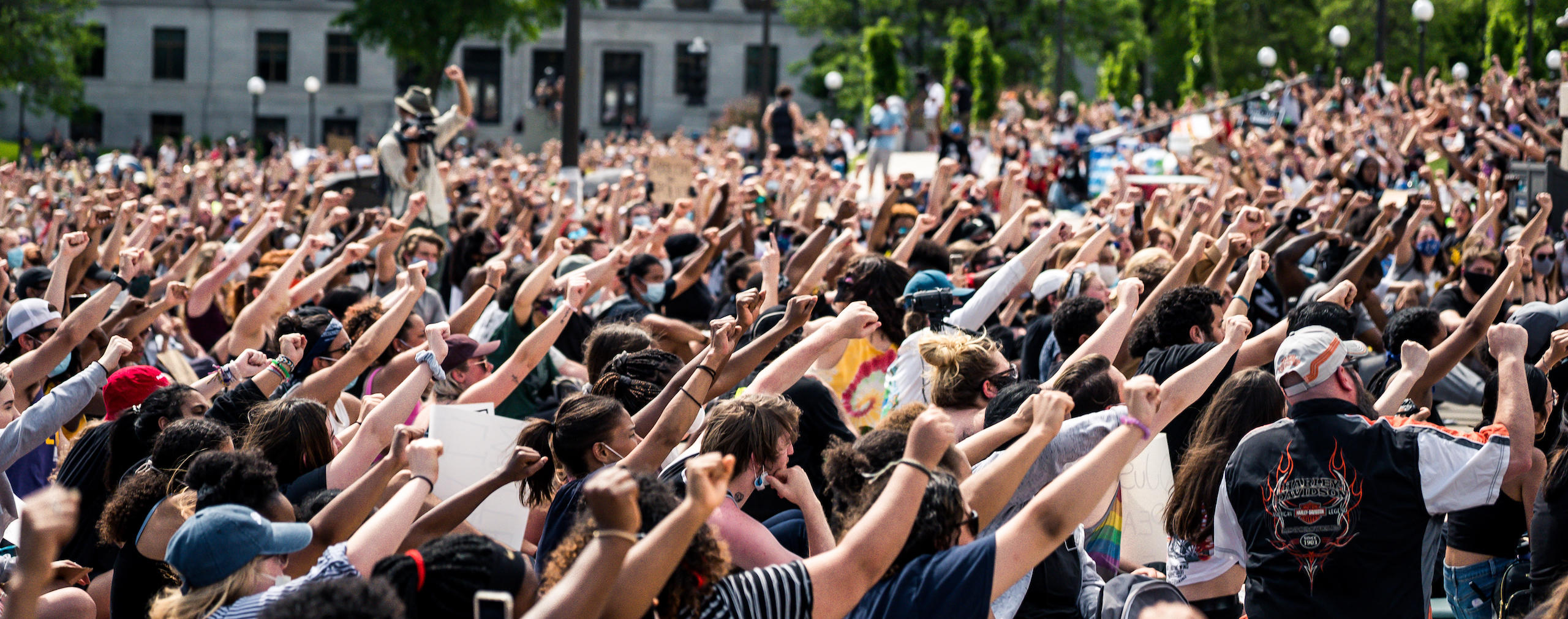 Protestors with hands raised