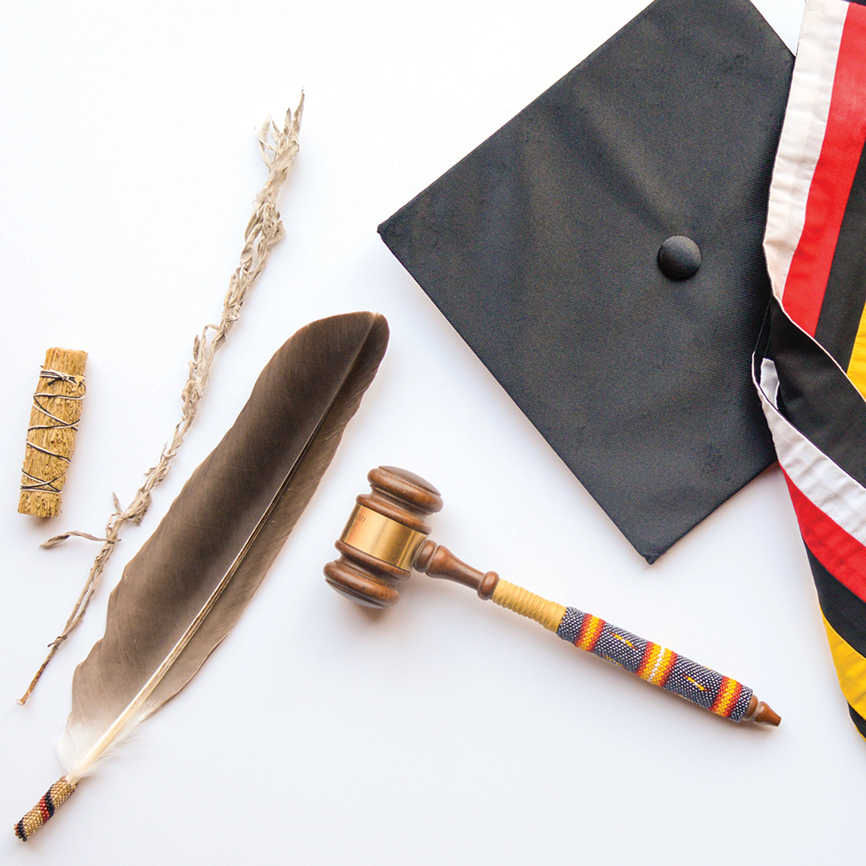 An image showing artifacts from UMD's history. Sage, a feather, a gavel, and graduation cap and stole.