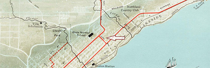 On a map an arrow points to the four-block stretch of trolley car line that was laid on 24th Avenue East in 1902. This section connected the existing Superior Street line and the Fourth Street line, specifically to serve the Duluth Normal School.