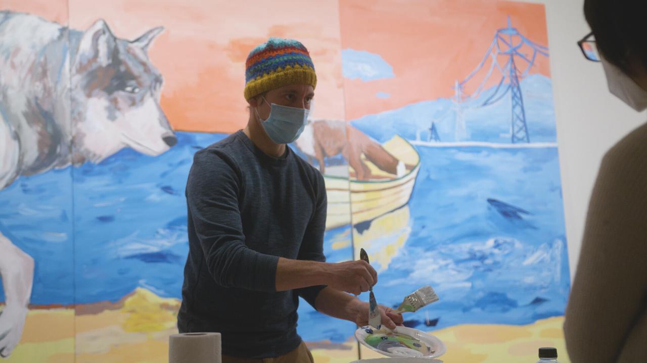 Artist Adam Swanson works at the Tweed