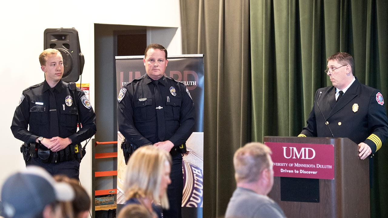 UMD police officers being awarded by the Duluth City Fire Department