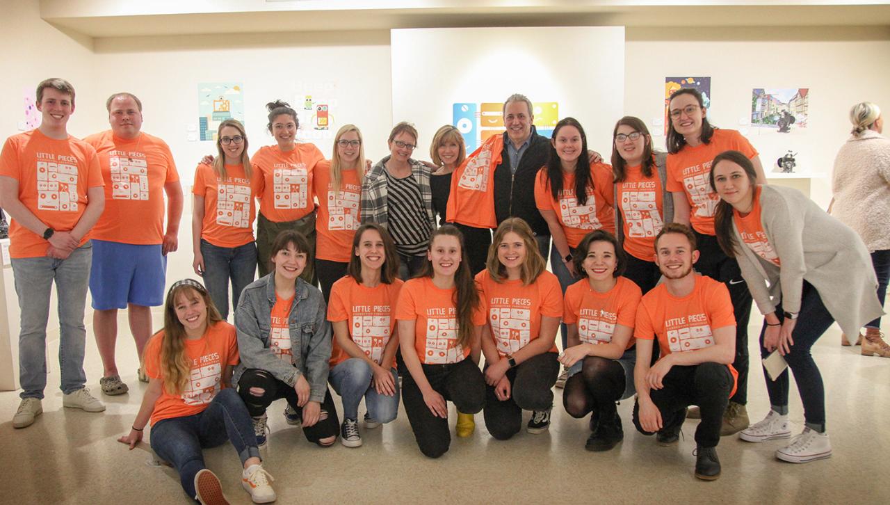 UMD senior graphic design students at their Tweed fundraiser exhibition