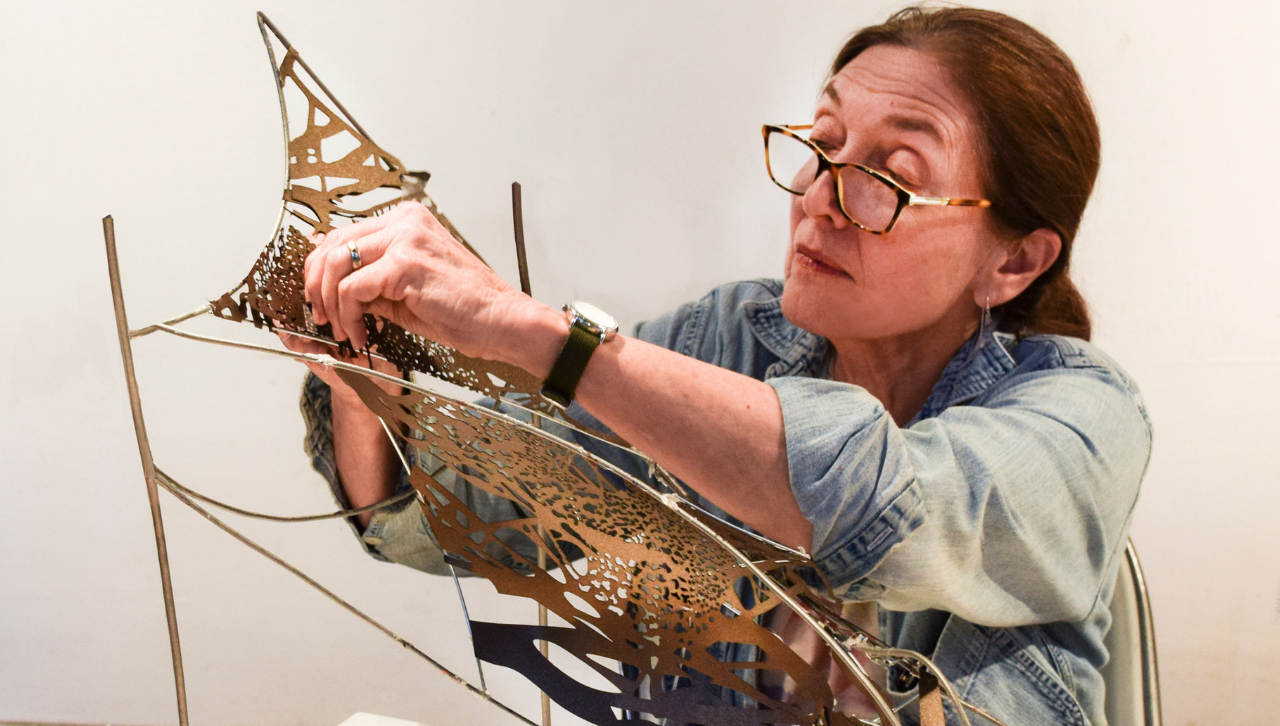 Artist Maria Artemis working on a small-scale version of Polytropos, UMD's sculpture
