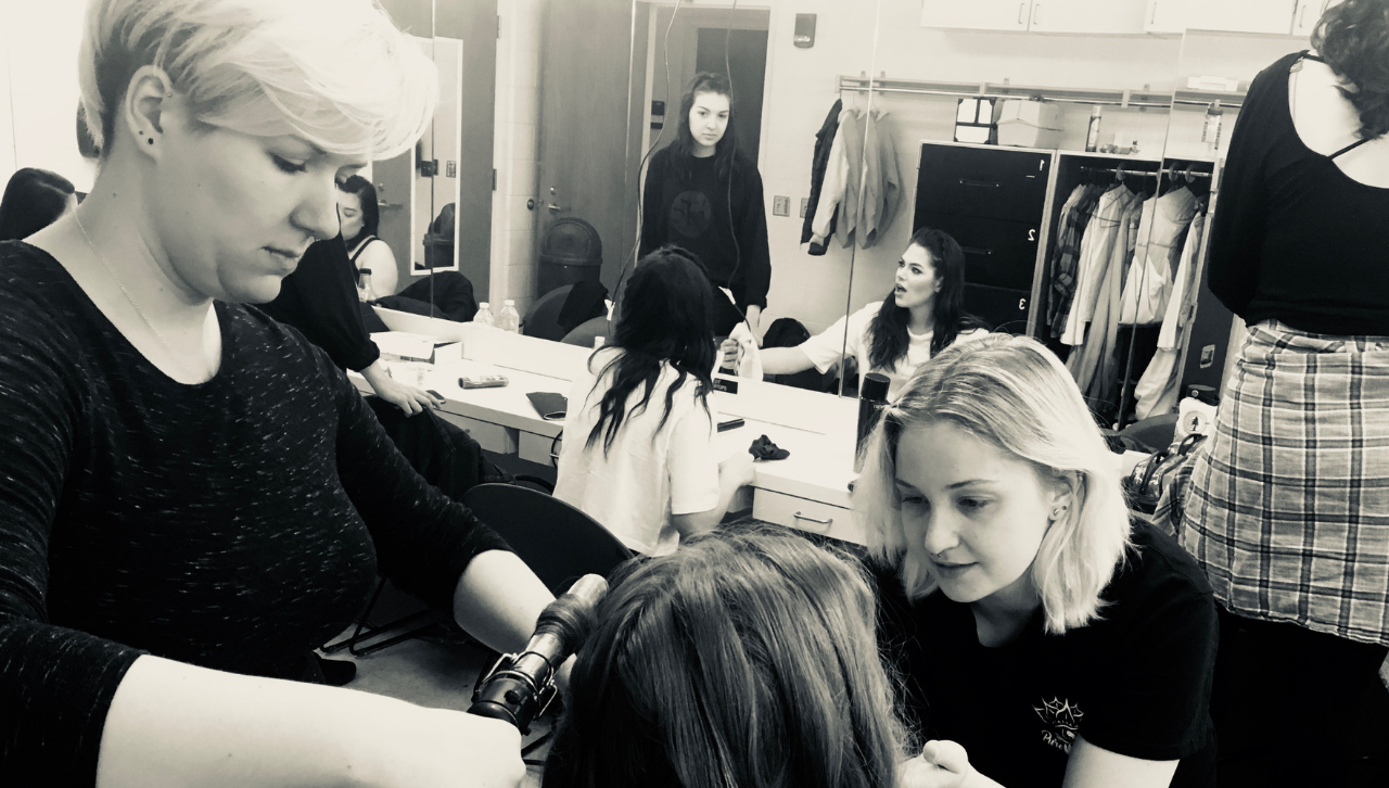 Tascha Balsaitis (Costume Designer) and Madi Lang (Dresser and Dramaturg) help Jenessa Iverson with hair and make-up before a performance of Time's Up at Western Michigan University (May 2019).